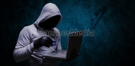 composite image of hacker using credit