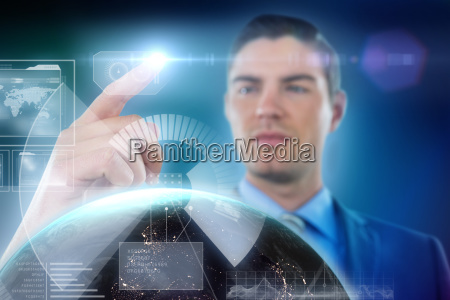 composite image of businessman touching digital