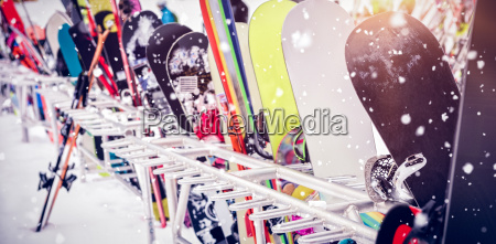 snowboards and skis kept together