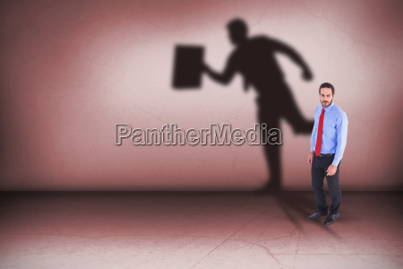 composite image of serious businessman in