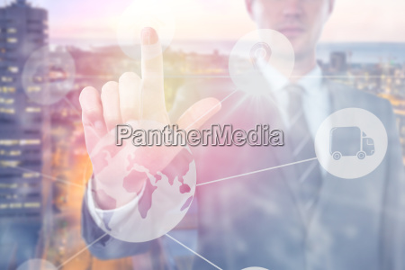 composite image of businessman using futuristic