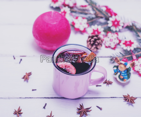 pink cup with mulled wine