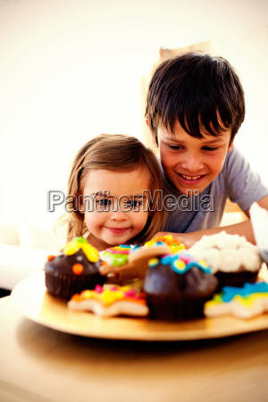 brother and sister looking at confectionery