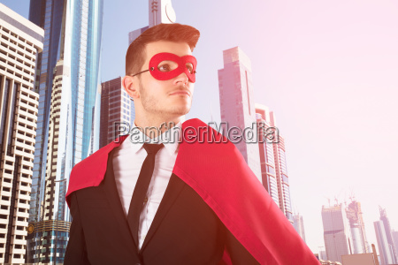 superhero businessman with buildings in background