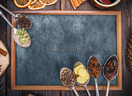 empty black chalkboard and spices in