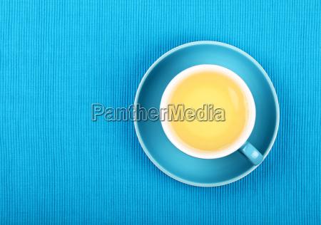 full cup of green tea close