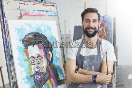 portrait smiling confident male artist painting
