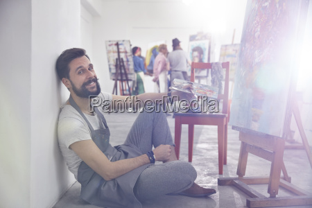 portrait smiling male artist with palette
