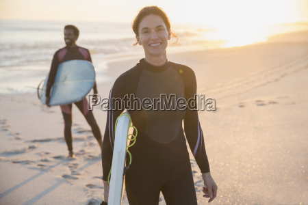 portrait confident woman in wet suit