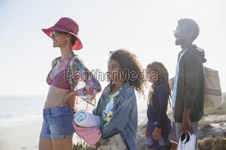 multi ethnic family standing on sunny