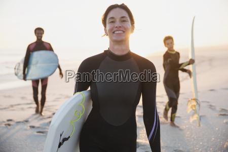 portrait smiling female surfer in wet
