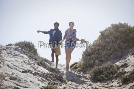 playful energetic multi ethnic couple running