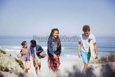 family walking with boogie board on