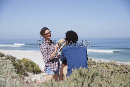 smiling multi ethnic couple talking on