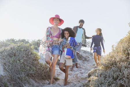 family walking on sunny summer beach