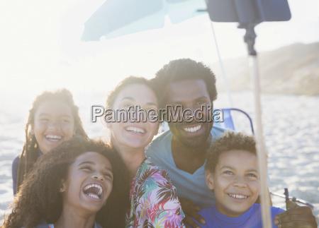 happy playful multi ethnic family taking