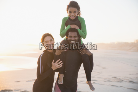 portrait smiling happy family in wet
