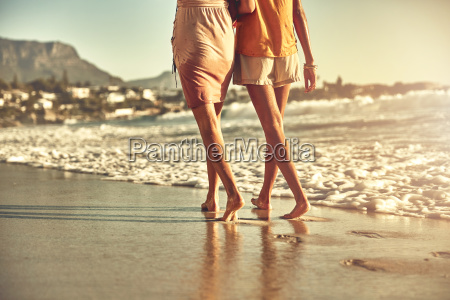 barefoot young women walking on sunny