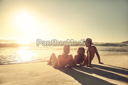 young friends relaxing on idyllic sunny
