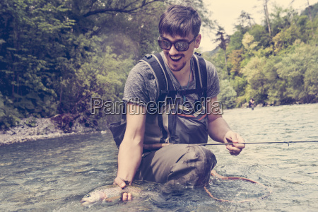 slovenia man fly fishing in soca