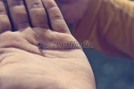 close up of fishhook in hand