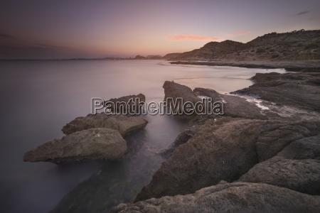 spain alicante rock coast at dusk
