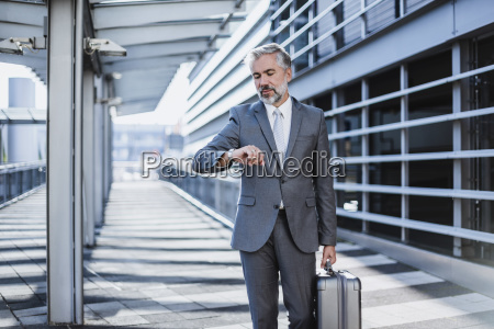 businessman on a business trip checking