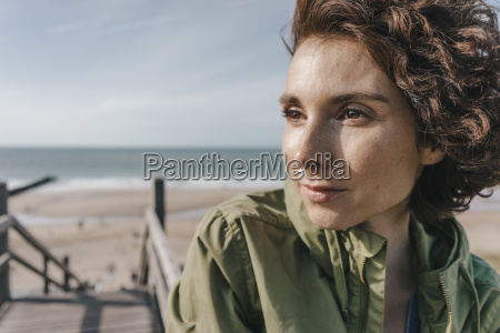 portrait of woman on boardwalk at