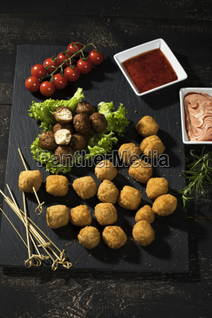meatballs and vegetable balls with dips
