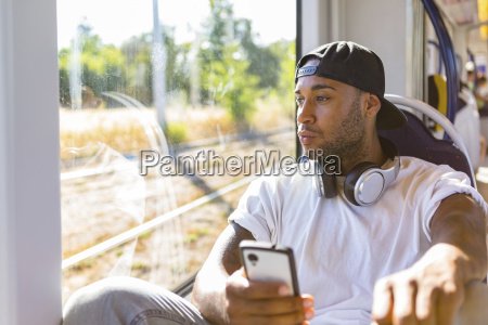 young man in tramway looking out