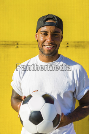 portrait of smiling man with soccer