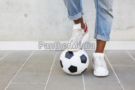 mans feet with soccer ball
