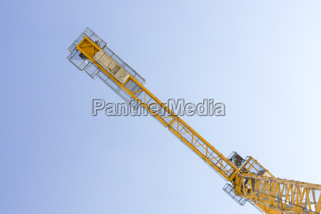 yellow crane against blue sky