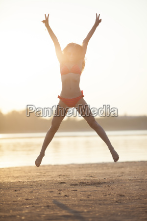 happy young woman jumping on the