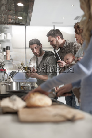 family and friends preparing a meal