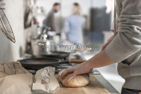 close up of man cutting bread