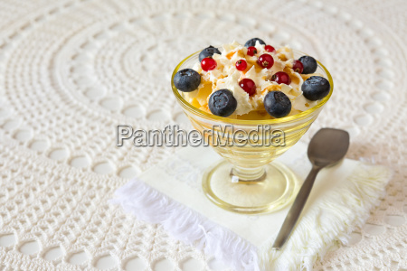dessert with berries and cream