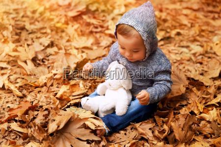 cute little baby in autumn park