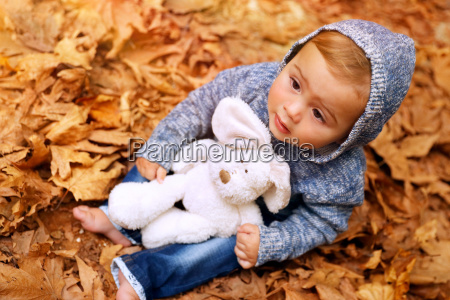 sweet baby in the autumn park