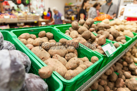 potatoes on supermarket vegetable shelf