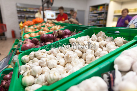 garlic on supermarket vegetable shelf