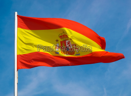 spanish flag of spain over blue