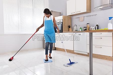 housewife doing multitasking household work