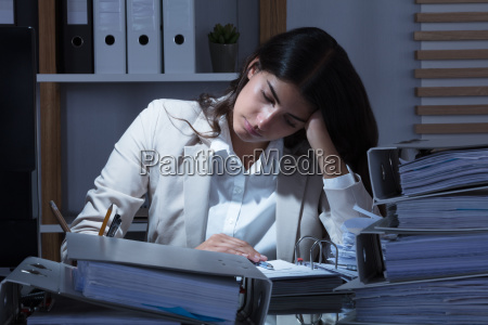 businesswoman working at office with stack