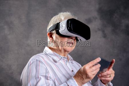 gray hairy elderly woman using virtual