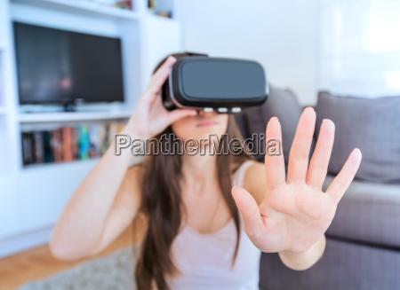 virtual reality glasses woman home