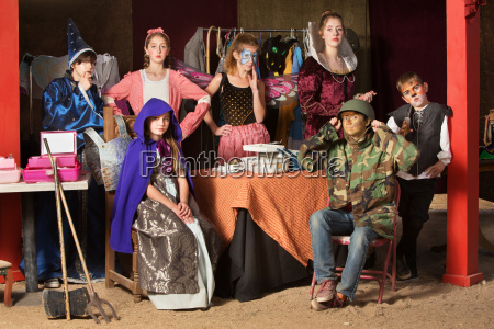 seven theater students in dressing room