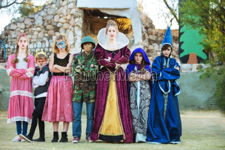 serious young actors in costume