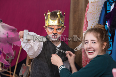 child actor dressed as king wearing