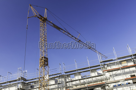 construction crane in front of new